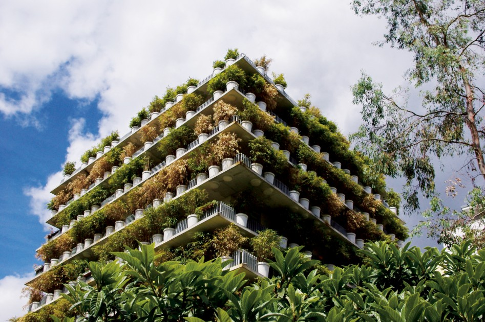 Potted plants cover all sides of a multistorey building